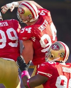 The San Francisco 49ers wore helmet decals to honor Joe Perry (34) and John Henry Johnson (35) during the 2011 season